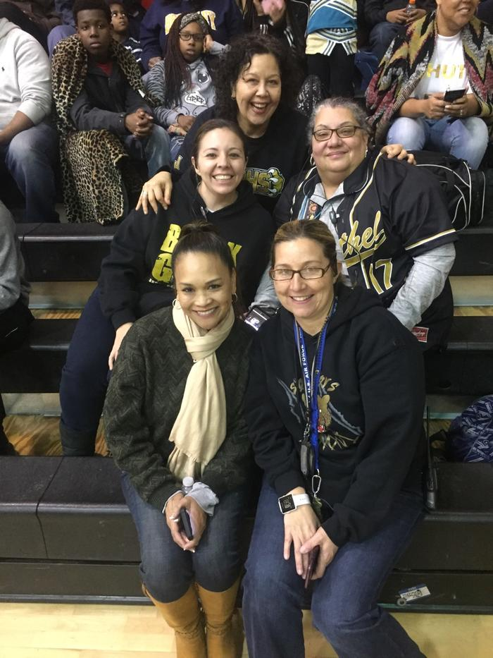 Administrators showing Bethel pride at the basketball game